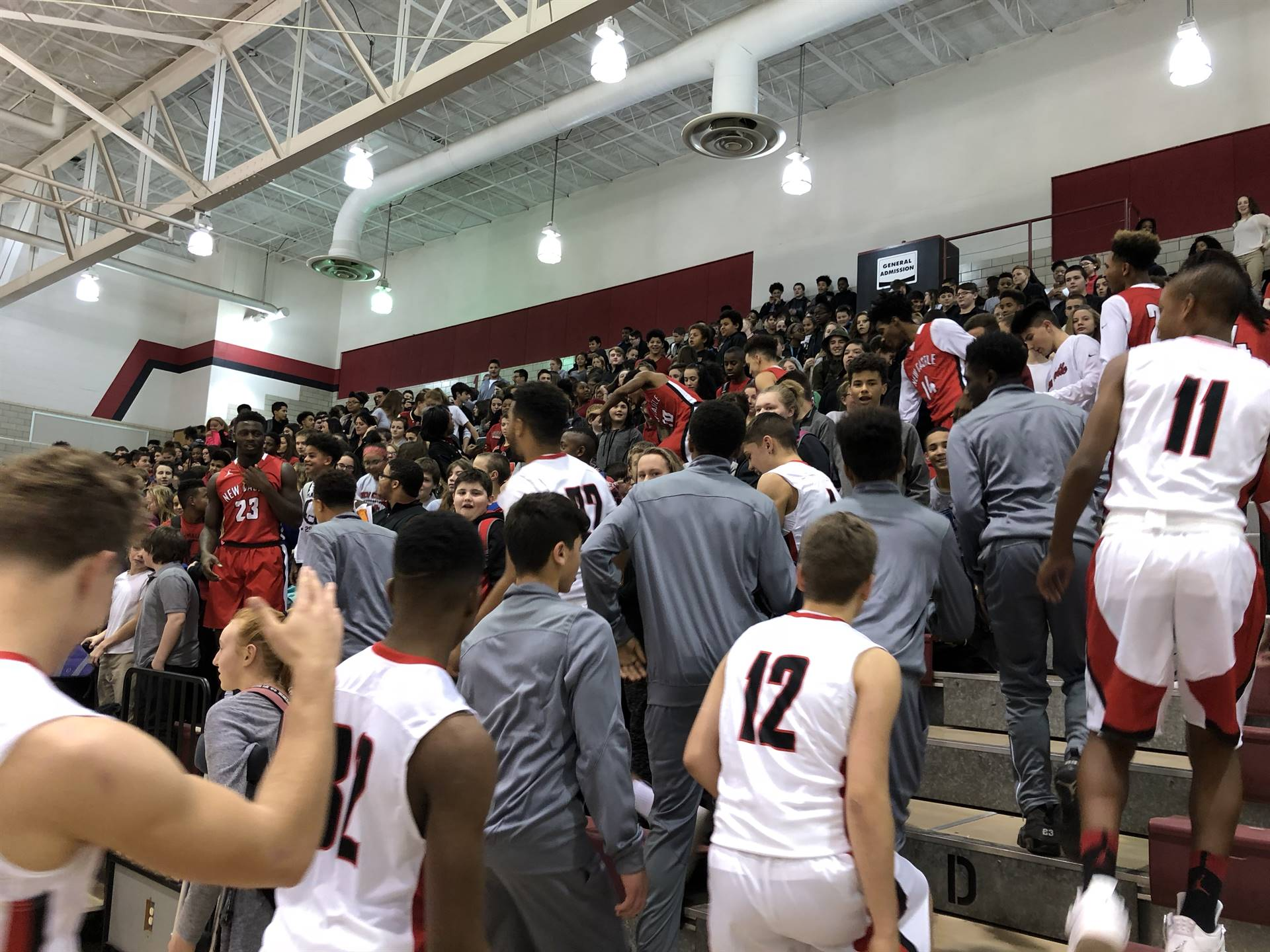 The 2017 Red Hurricanes lead the crowd in a cheer
