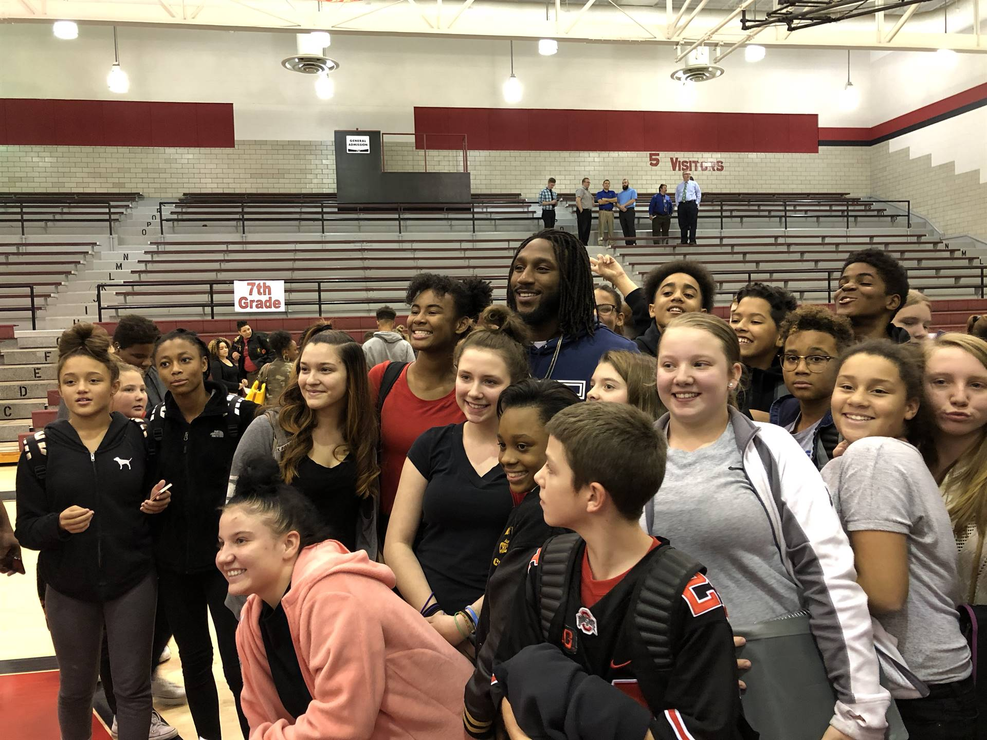 Malik poses with students after the pep rally