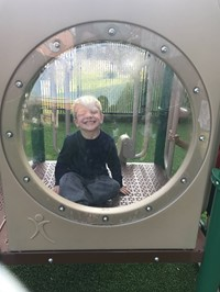 Pre-K student enjoying the newly renovated playground