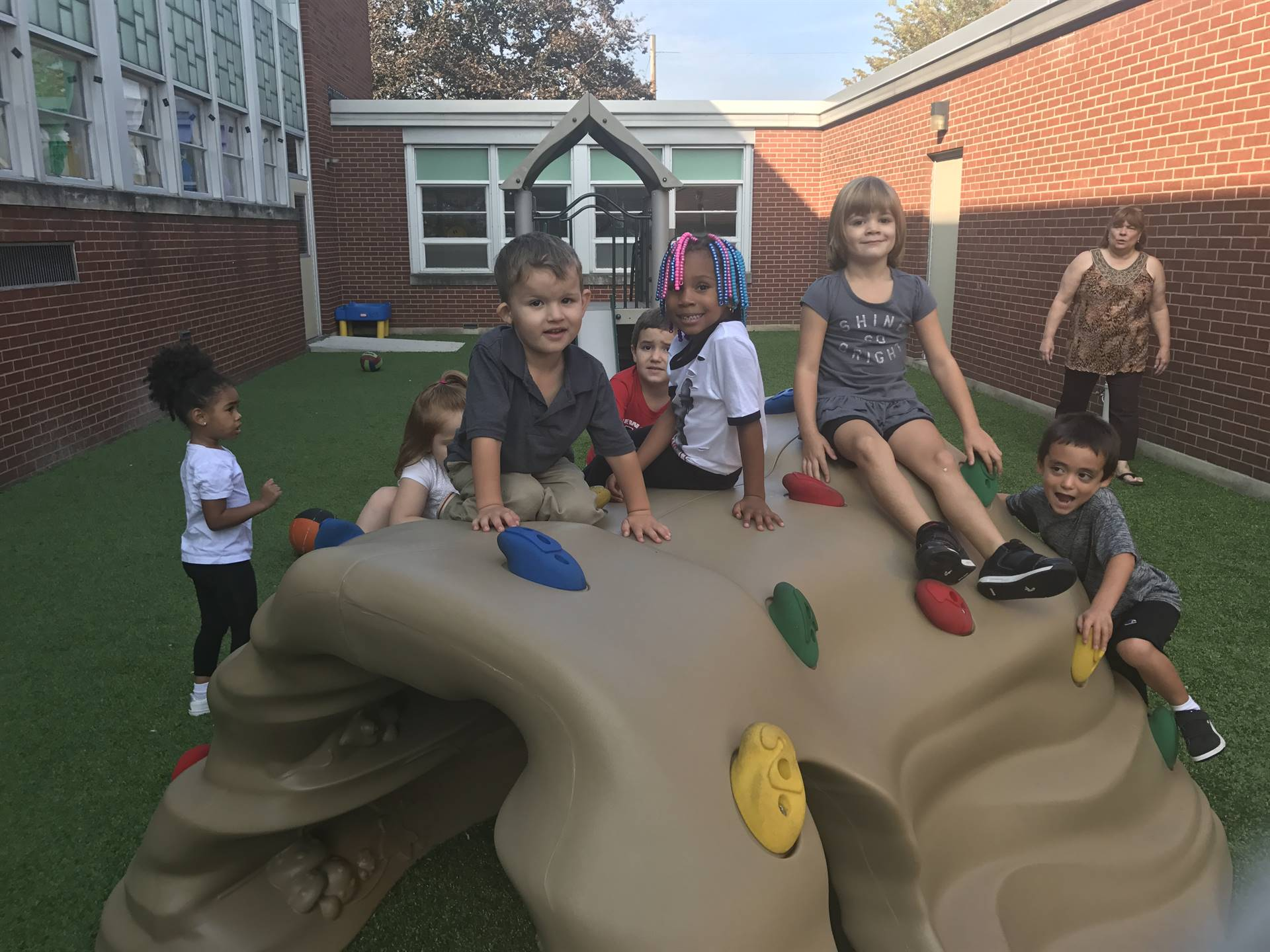 Pre-K students enjoying the newly renovated playground