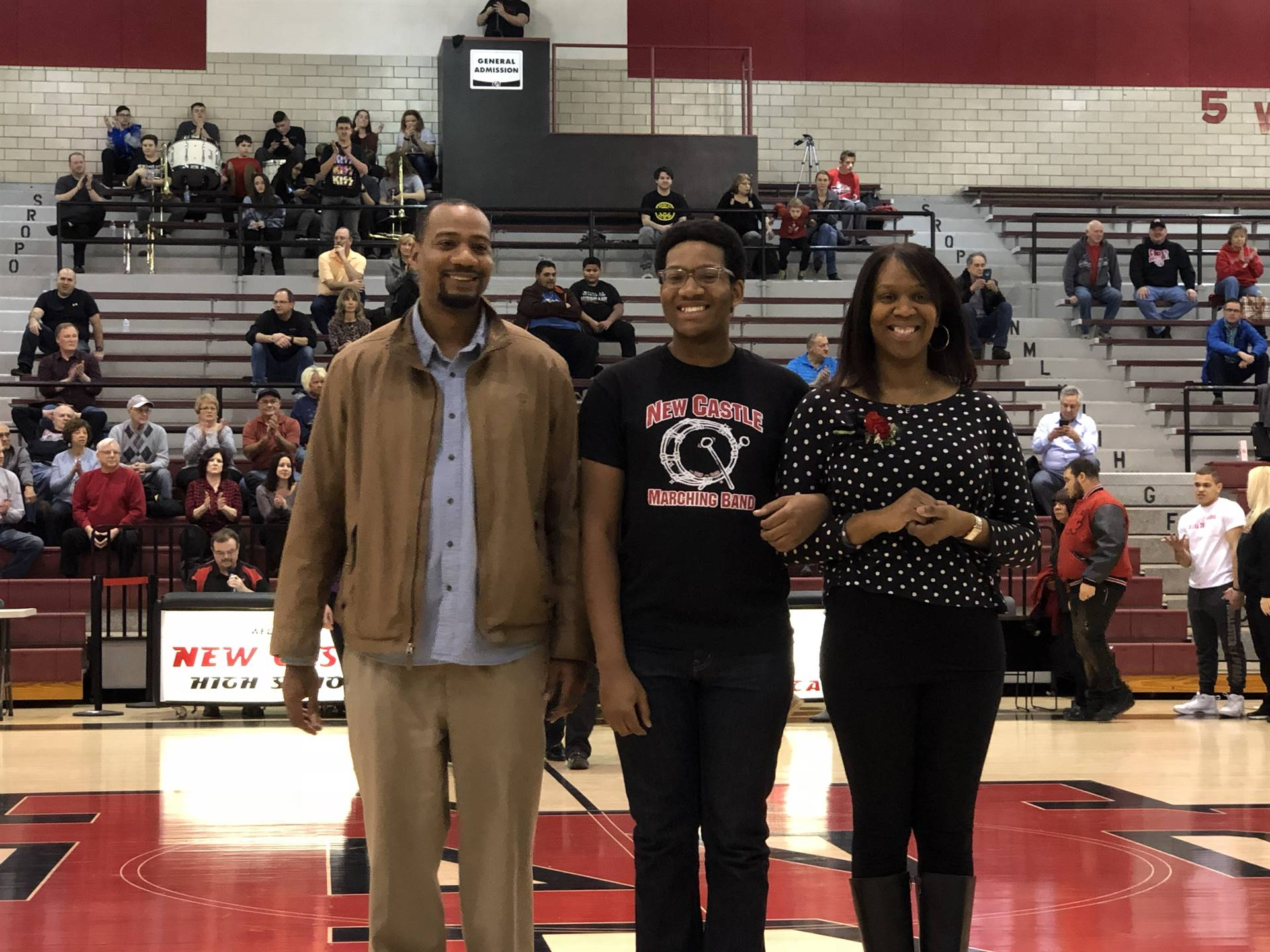 Eric Groves, escorted by Erika and Robert Groves