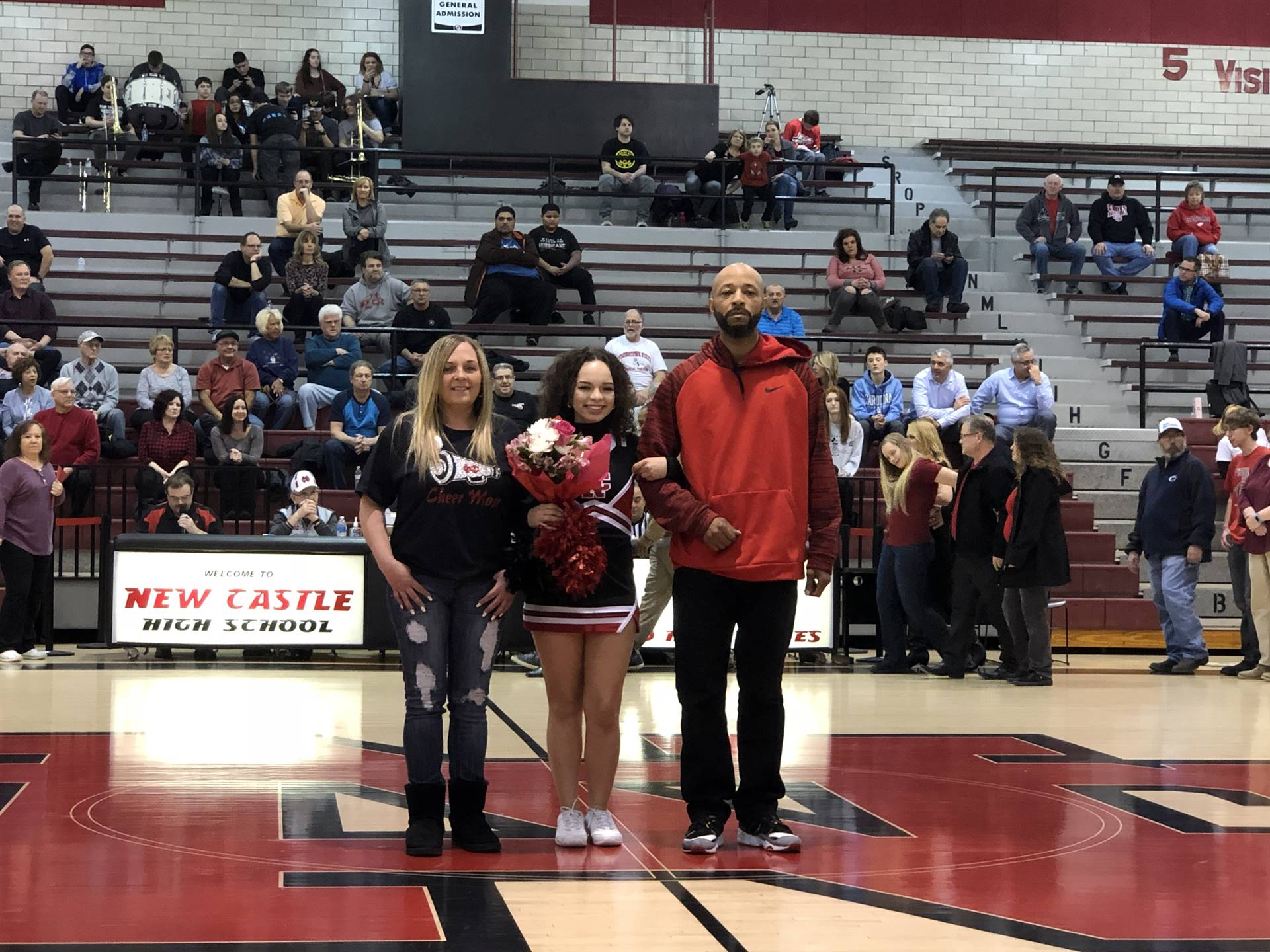 Hayla Tipper, escorted by Carla Lazar and Octavius Tipper
