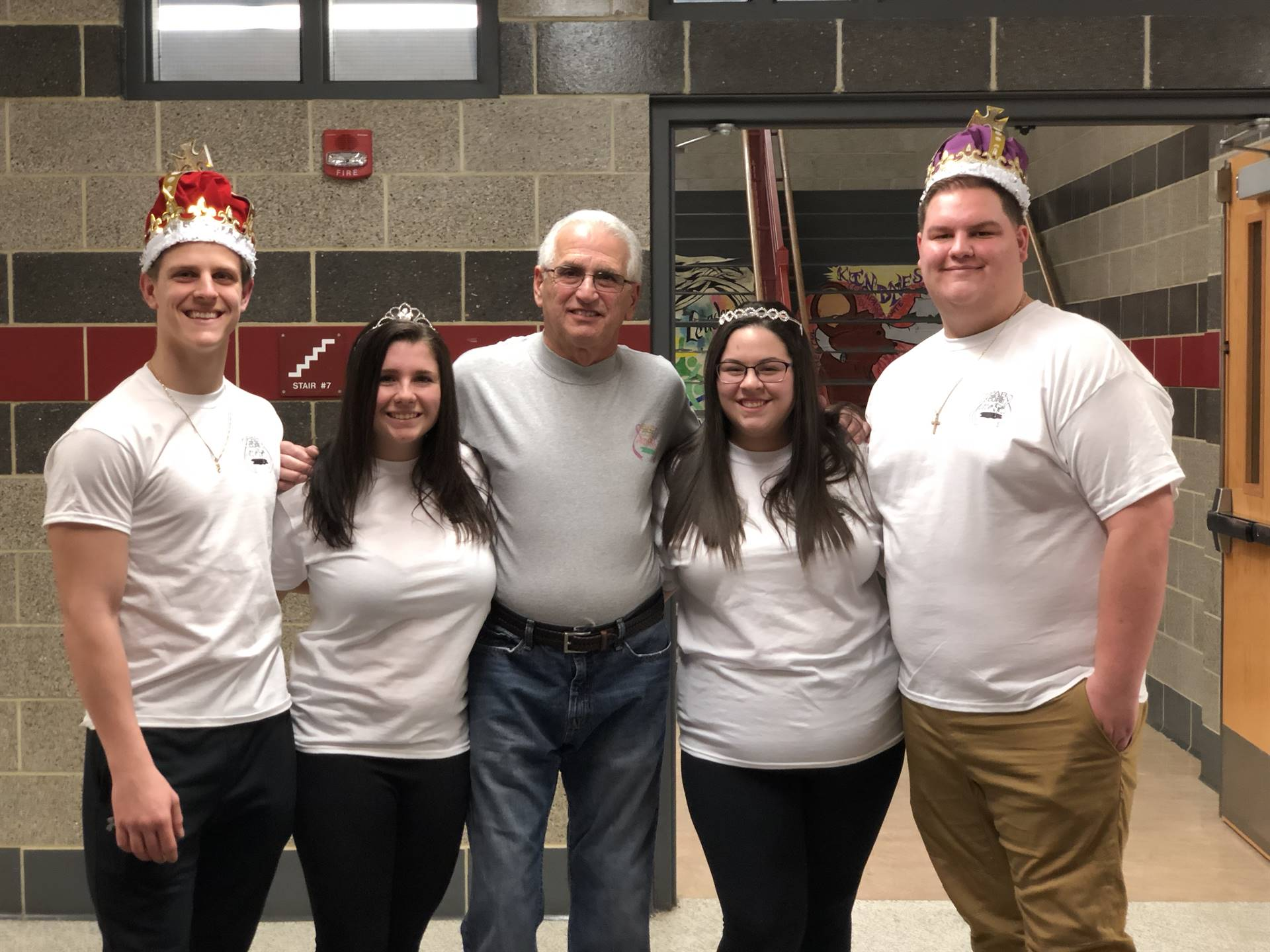 Mr. Andy Esposito poses with the 2018 King, Queen, Prince, and Princess of Hearts